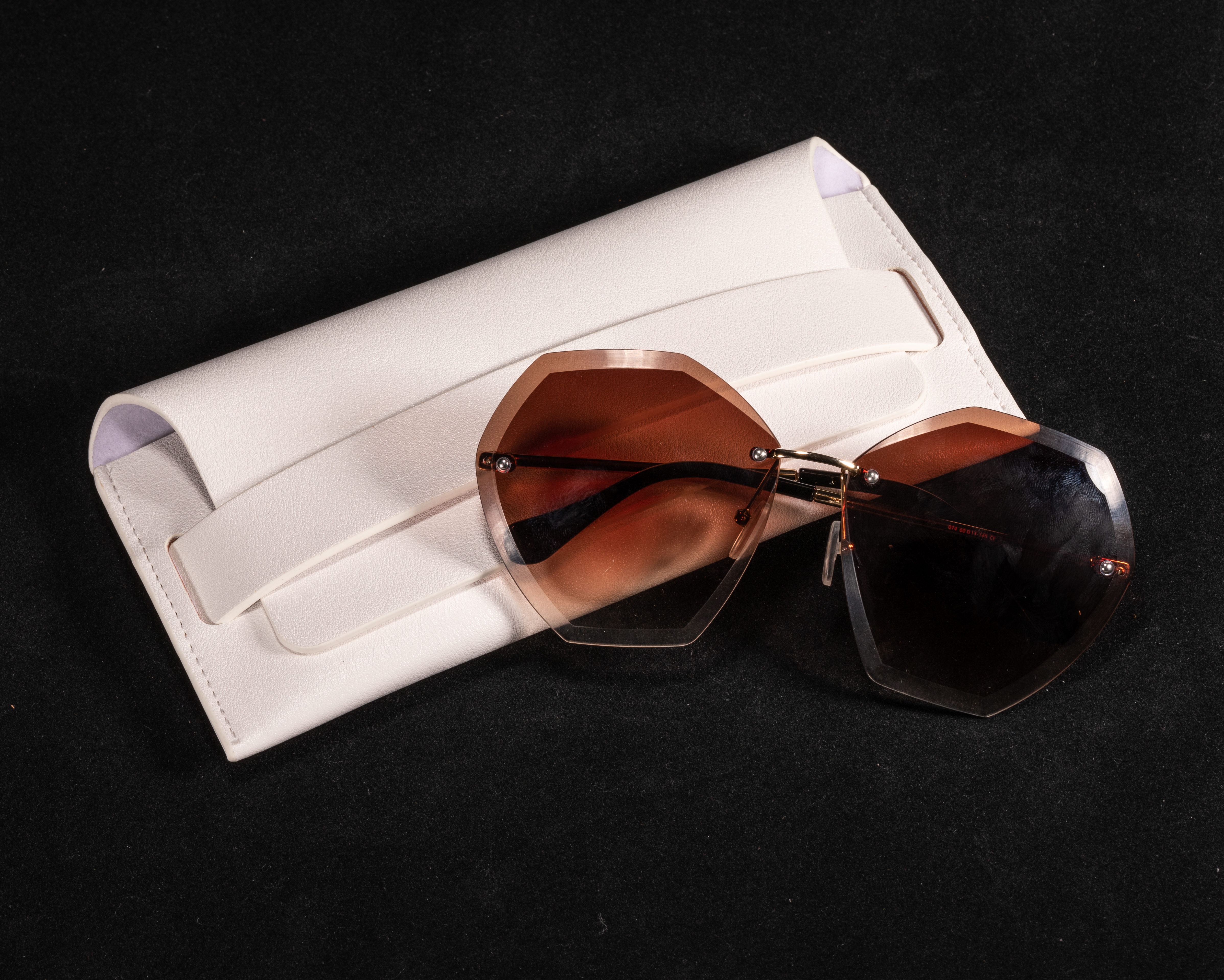 A White, Pocketed Eyeglass Case Shaped Like A Leather Bag