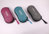 The Glasses Case with Four Colors Printed with The LOGO Is Zipped And Shaped Like A Peanut